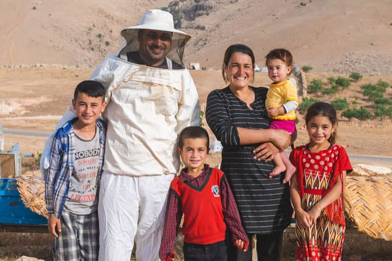 A beekeeper and his family