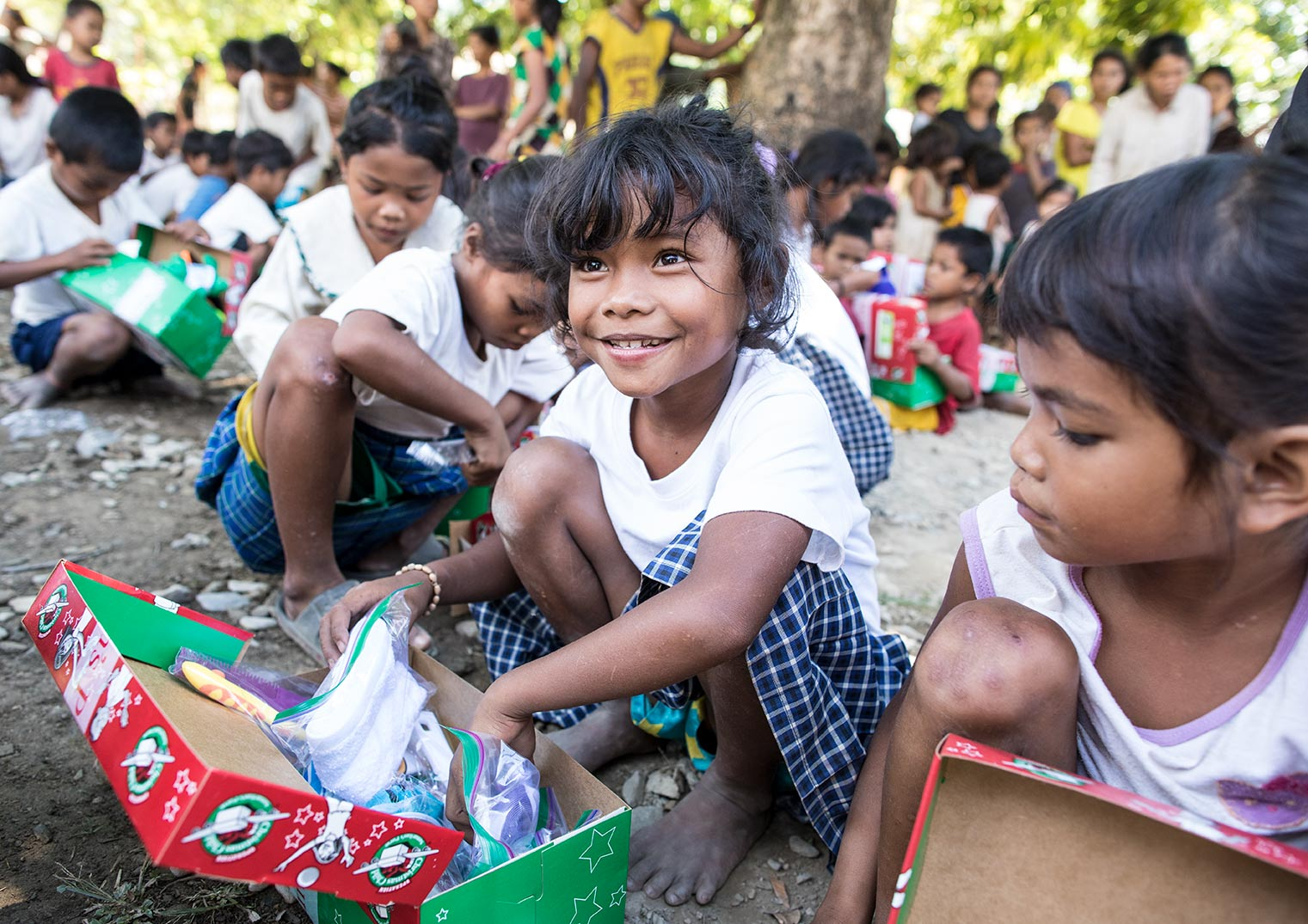 a girl in Saipan with her gifts