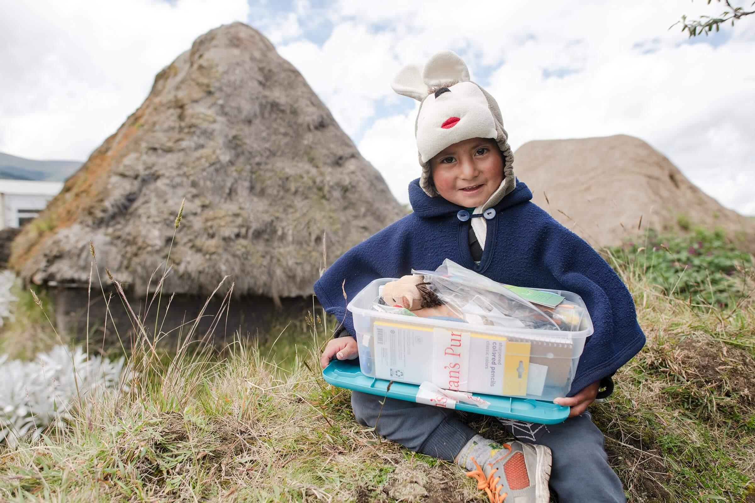 a boy in Ecuador with his shoebox gifts