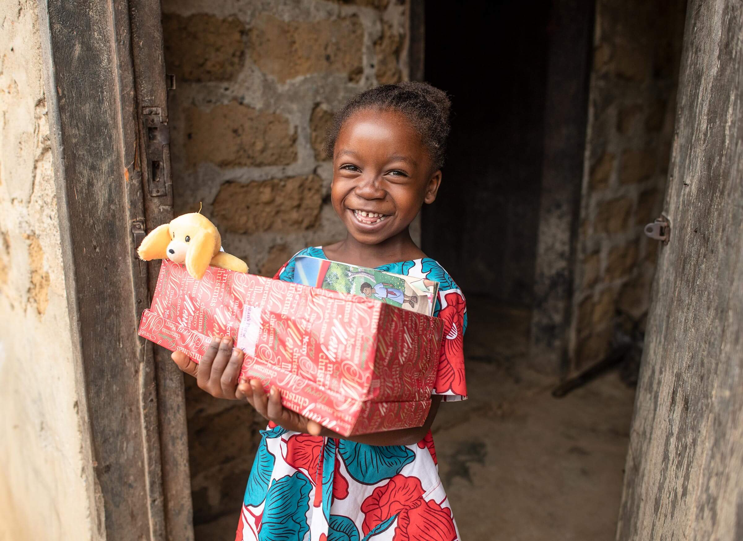 a girl in Liberia with her shoebox