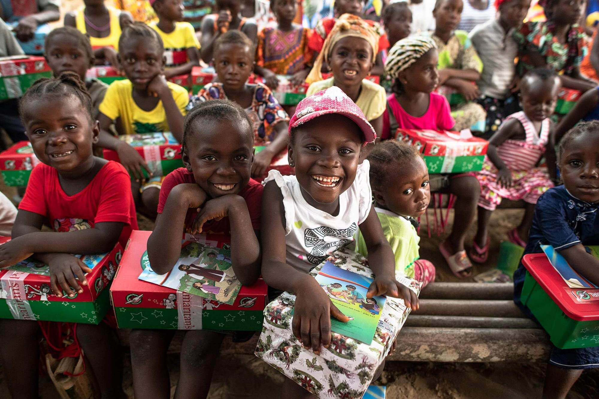 children in Africa with their shoeboxes