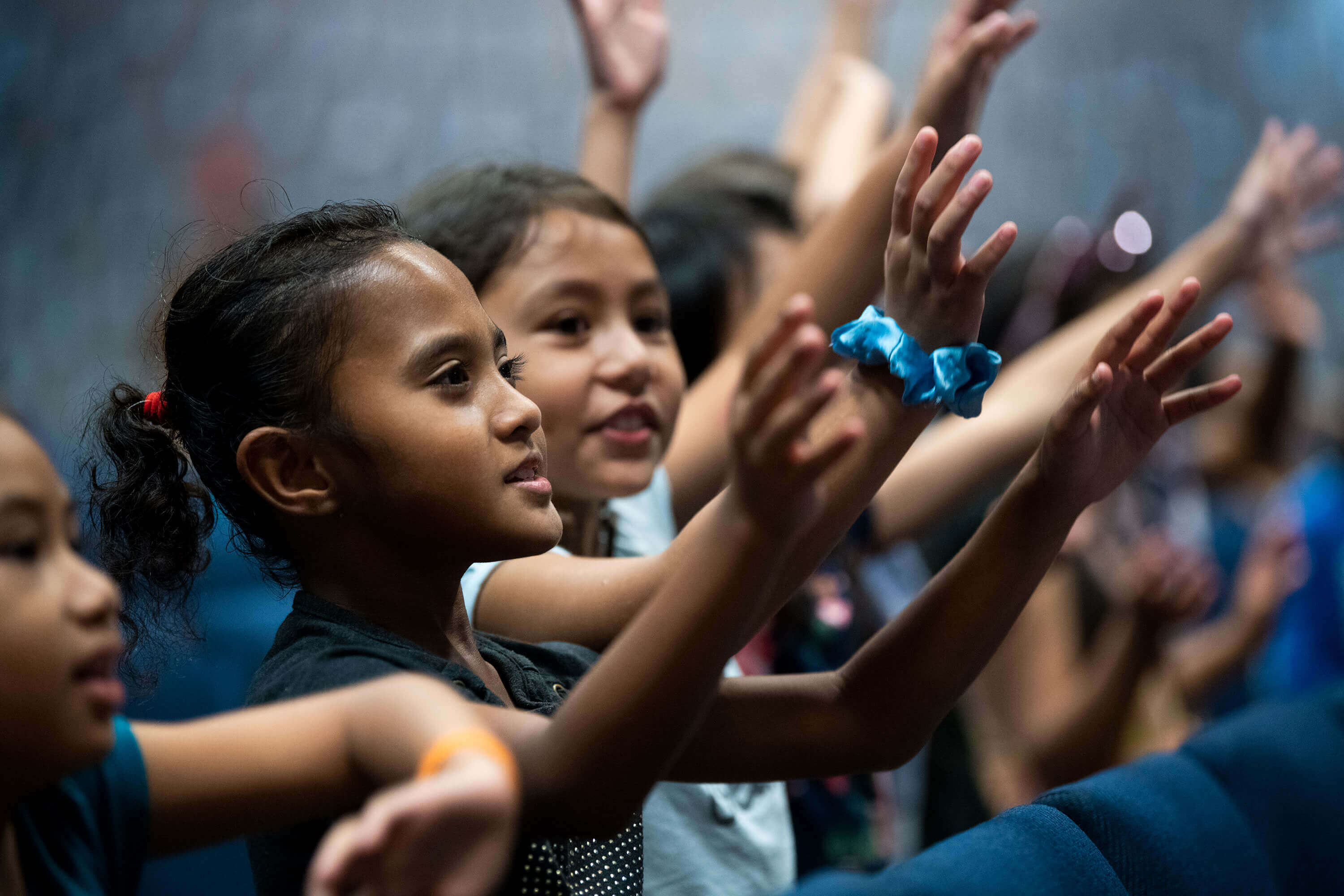 Children in Guam participating in a worship service