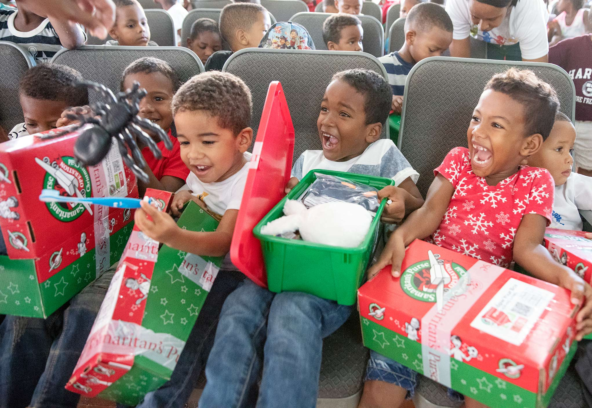children opening their shoebox gifts