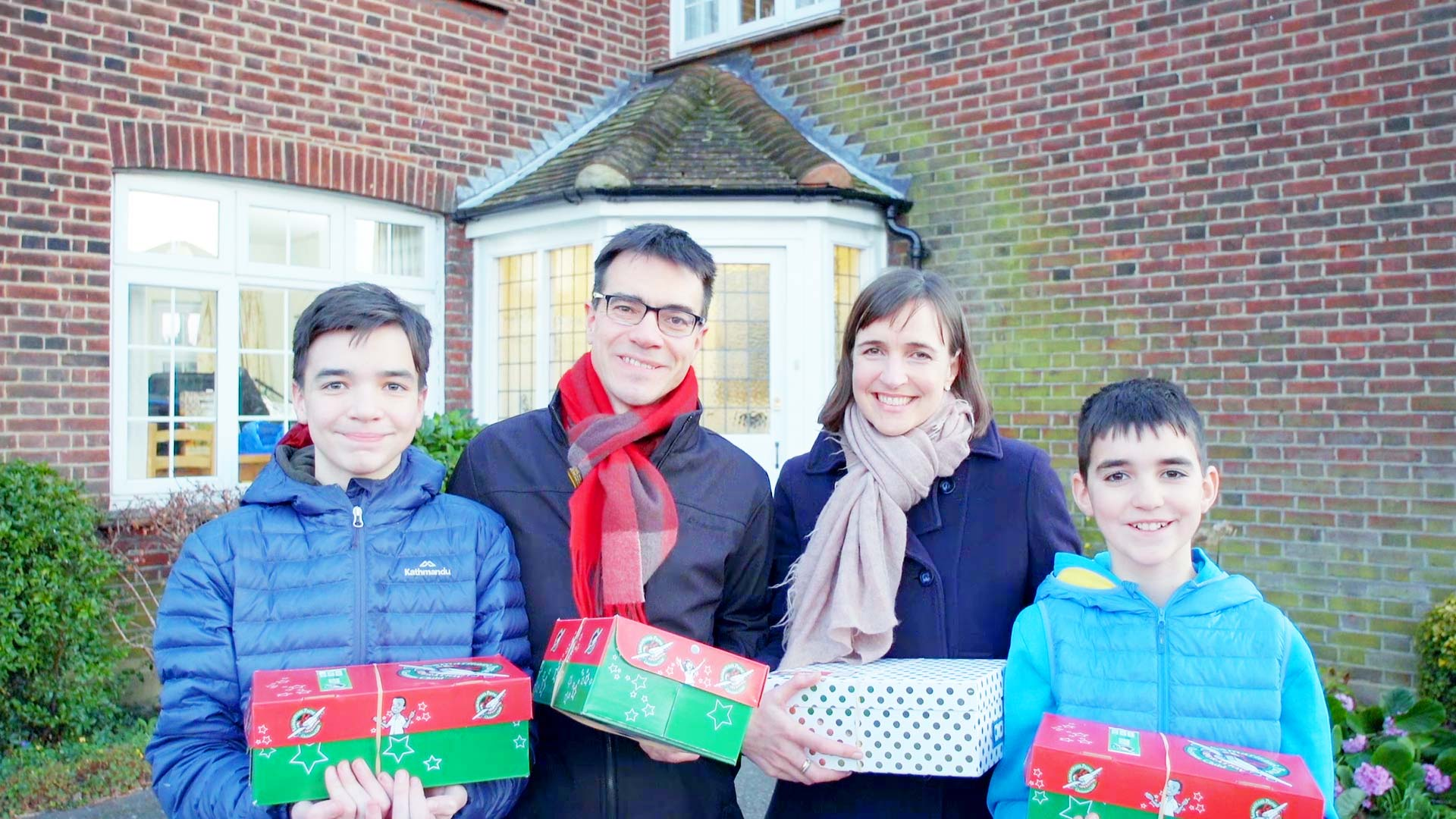 a family packing shoeboxes